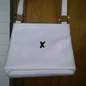 Paloma Picasso white leather.